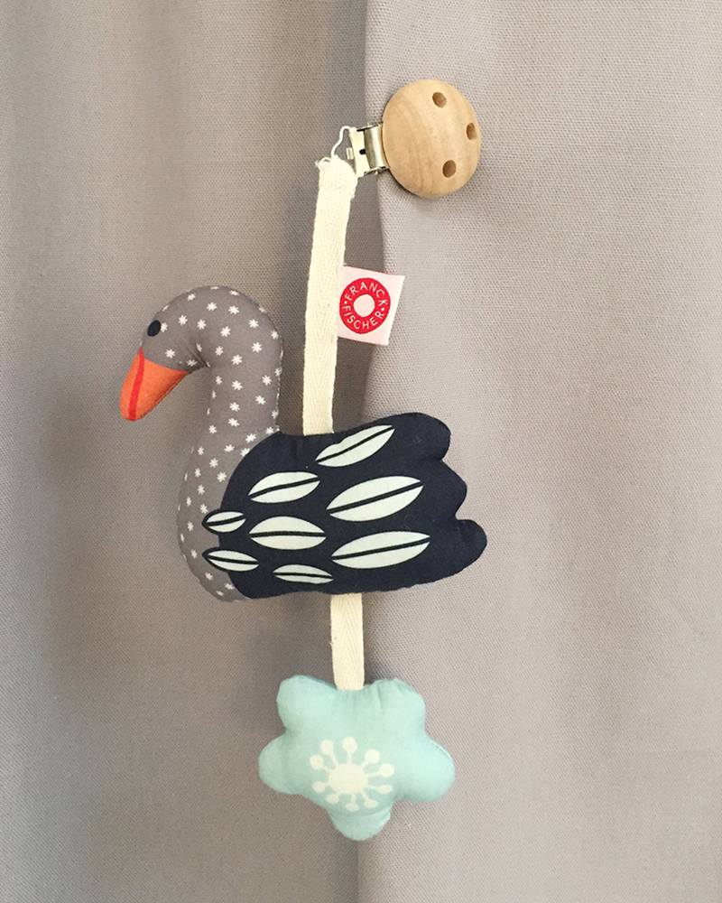 Tinka dark swan clip rattle